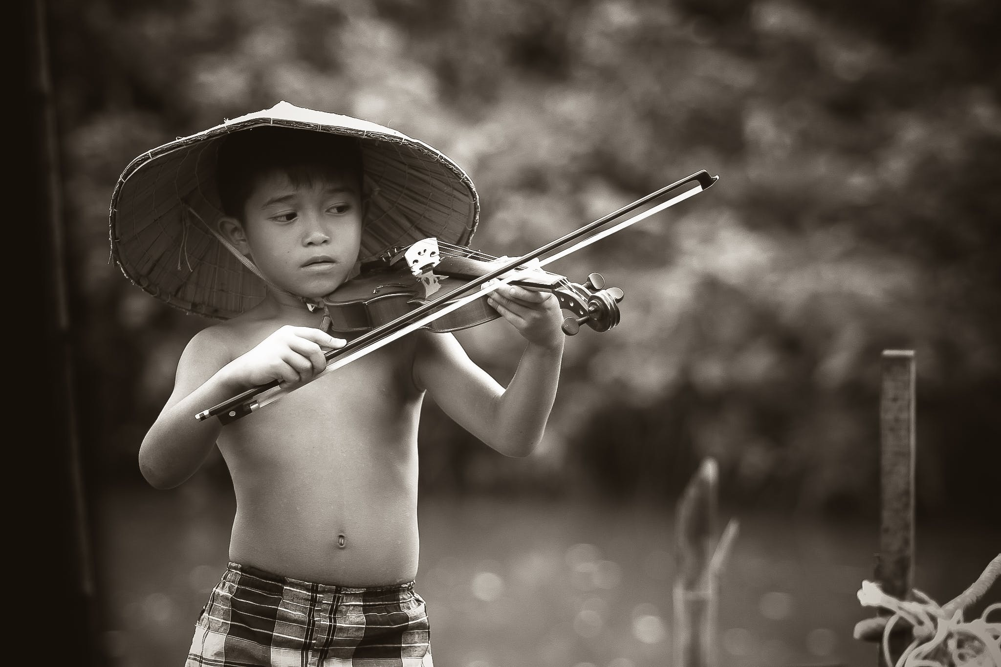 Grayscale Photography of Boy Playing Violin