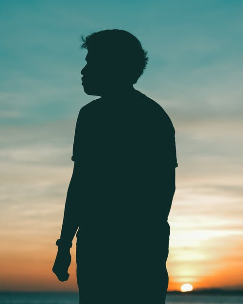 Silhouette Photo of Man During Sunset