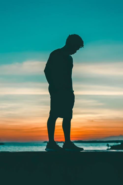 Silhouette Photo of Man During Dawn