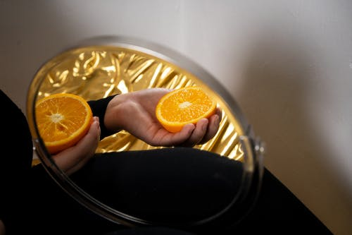 Person Holding Orange Citrus Fruit