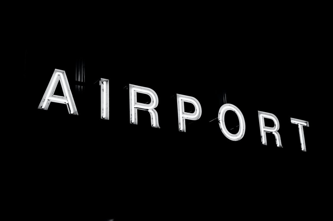 Airport Lighted Signage at Night