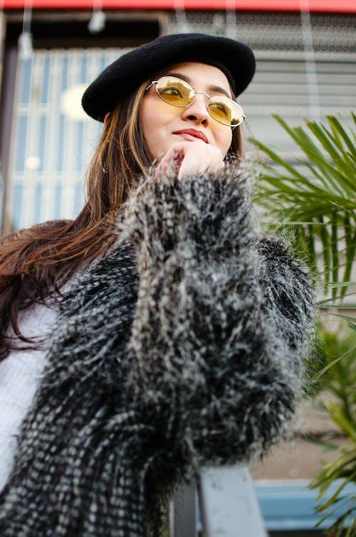 Woman in Black Fur Coat Wearing Sunglasses
