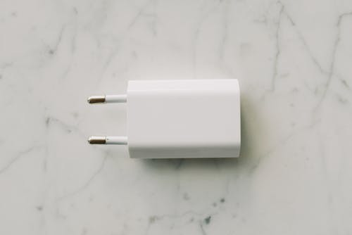 White Adapter On White Surface