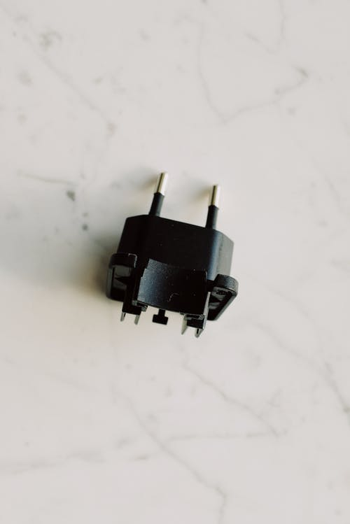 Black Adapter On White Surface