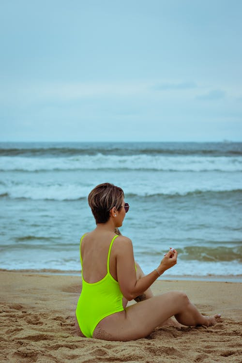Photo of Woman In Green Swimsuit