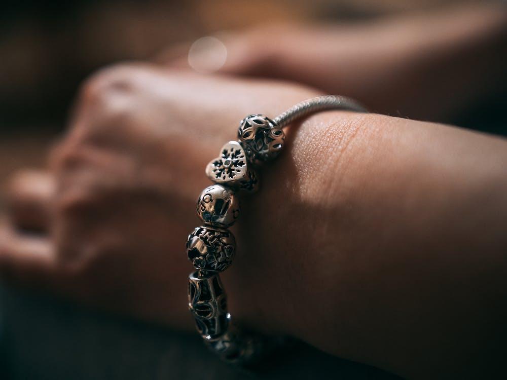 Close-Up Photo of Silver Charm Bracelet
