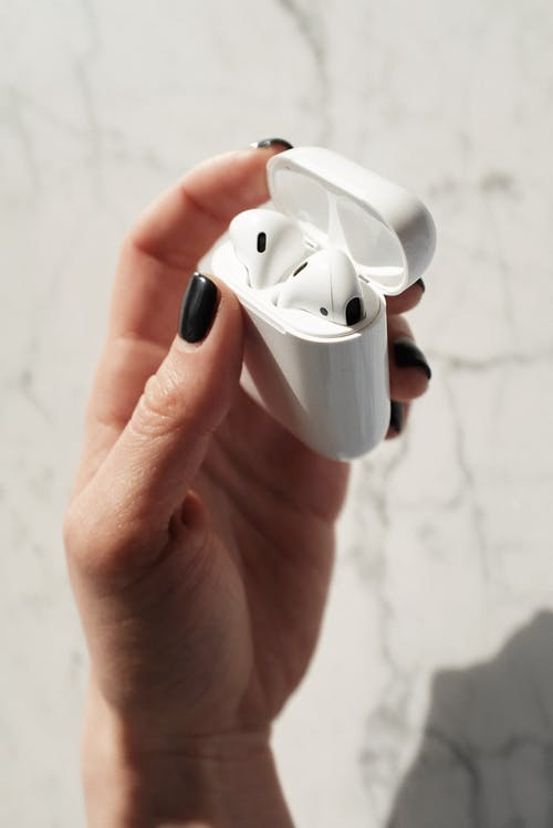 Person Holding White Apple Airpods
