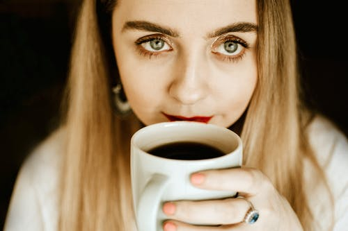 Photo of Woman Holding Coffee Cup