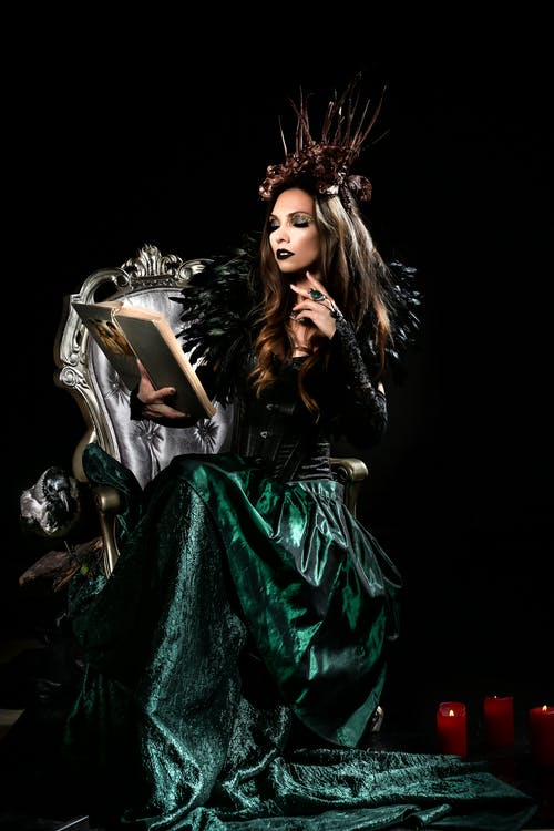 Woman In A Costume Reading A Book