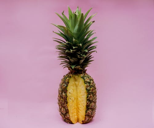Pineapple Fruit On Pink Surface