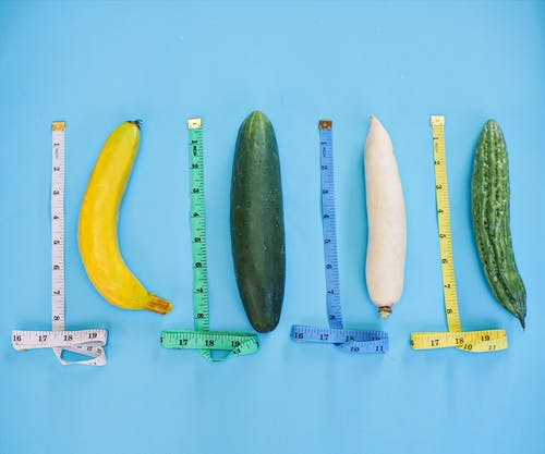 Yellow and Green Cucumber on Blue Surface