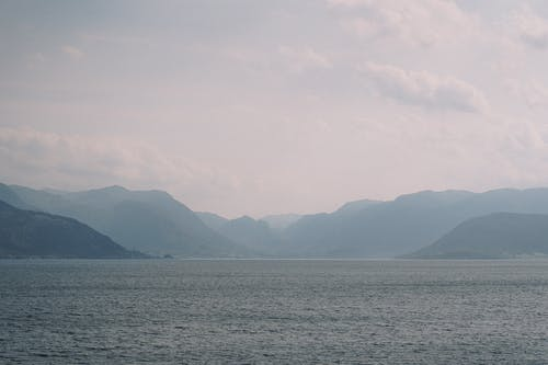 Body Of Water Near Mountains