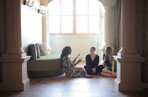 Women Sitting On The Floor