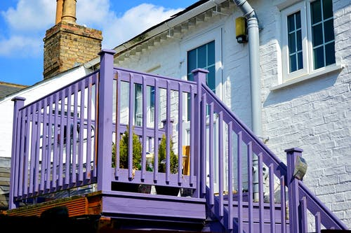 Purple Wooden Stairs and Handrail Under Sunny Sky
