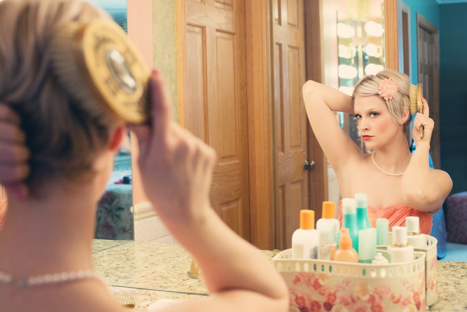 Woman Using Hair Brush