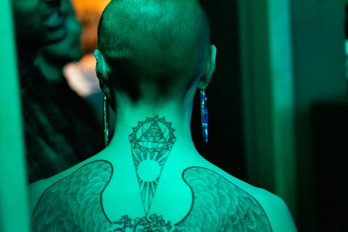 Person With Tattoos On The Back