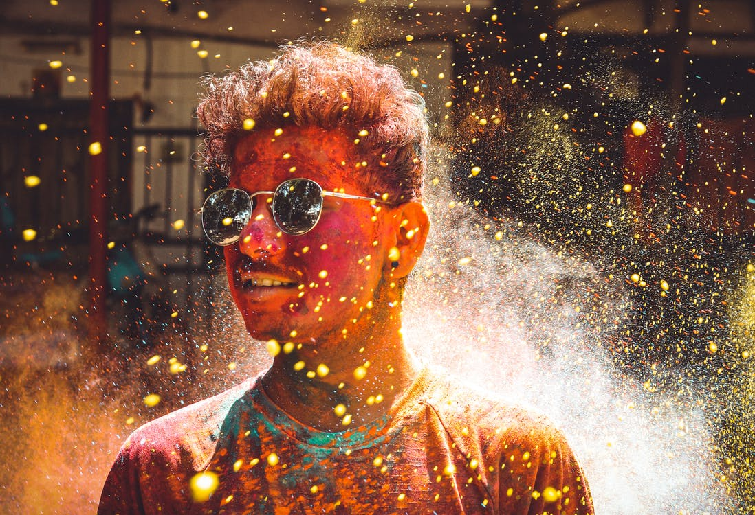 Man Covered In Colored Powder