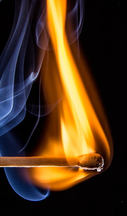 Match Stick Give Orange Fire With a White Smoe