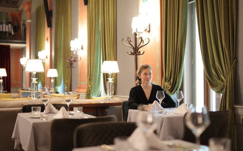 Woman In A Restaurant Sitting Alone