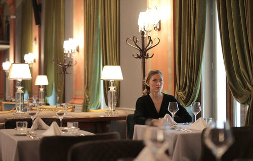 Woman Sitting Alone In A Restaurant