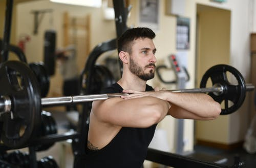 Man In Black Tank Top Working Out