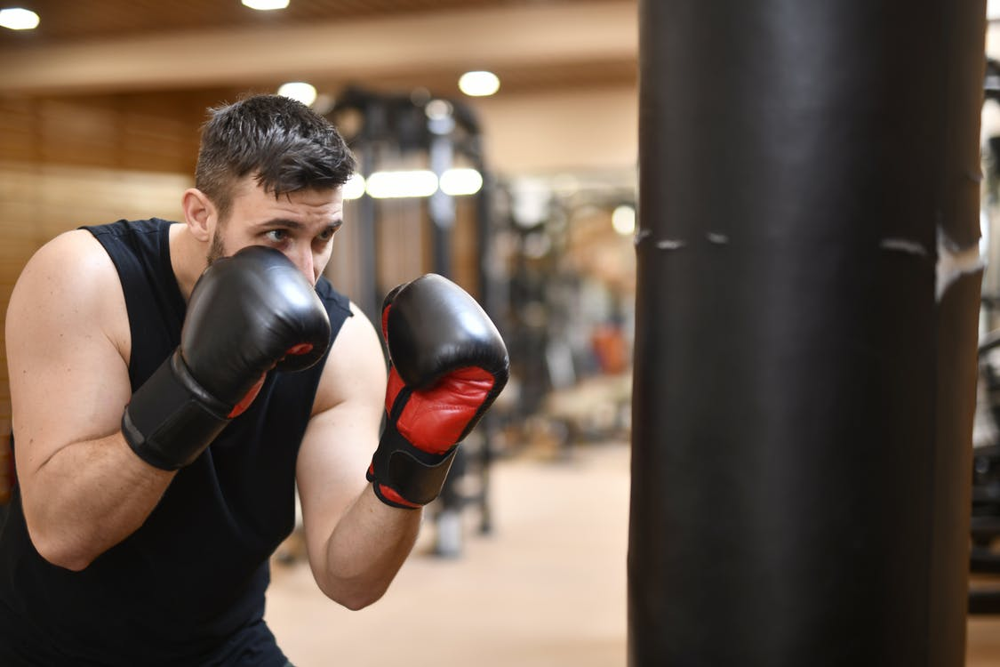 Man In Black Tank Top Wearing Black And Red Boxing Gloves