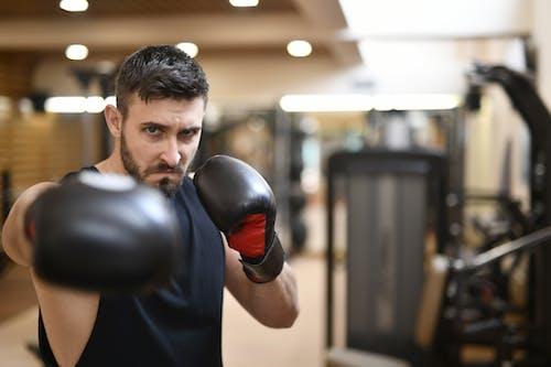 Man Wearing Black Boxing Gloves