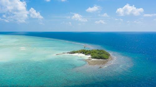 Green island in blue sea