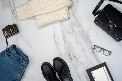 Flat Lay Of Clothing And Accessories