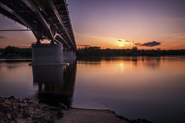 Gray Metal Bridge Above Body of Water