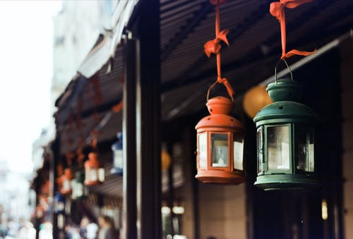 Metal lanterns hanging on building entrance during Christmas holidays