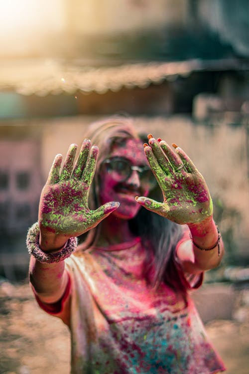 Woman's Hands Covered In Colored Powder