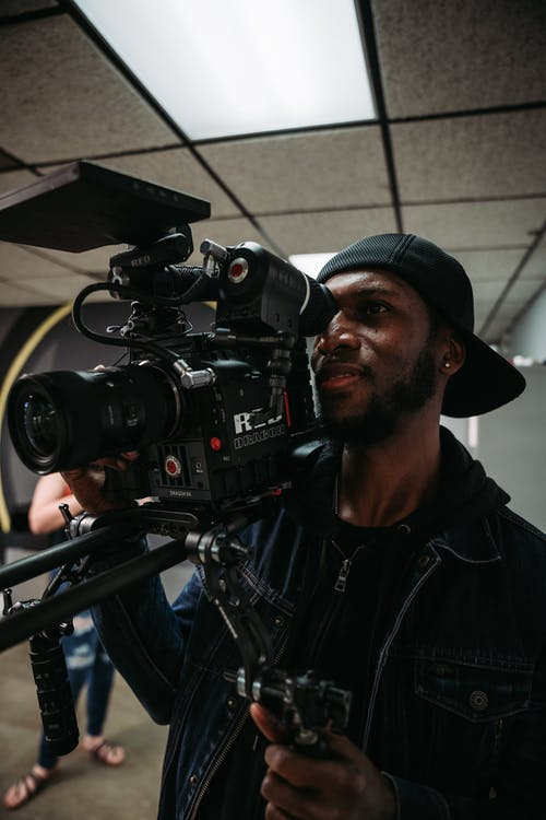 Man Holding Professional Video Camera
