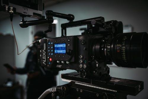 Black Video Camera on Black Table