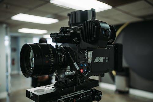 Black Dslr Camera on Black Table