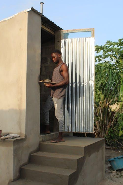 Man Standing By The Door