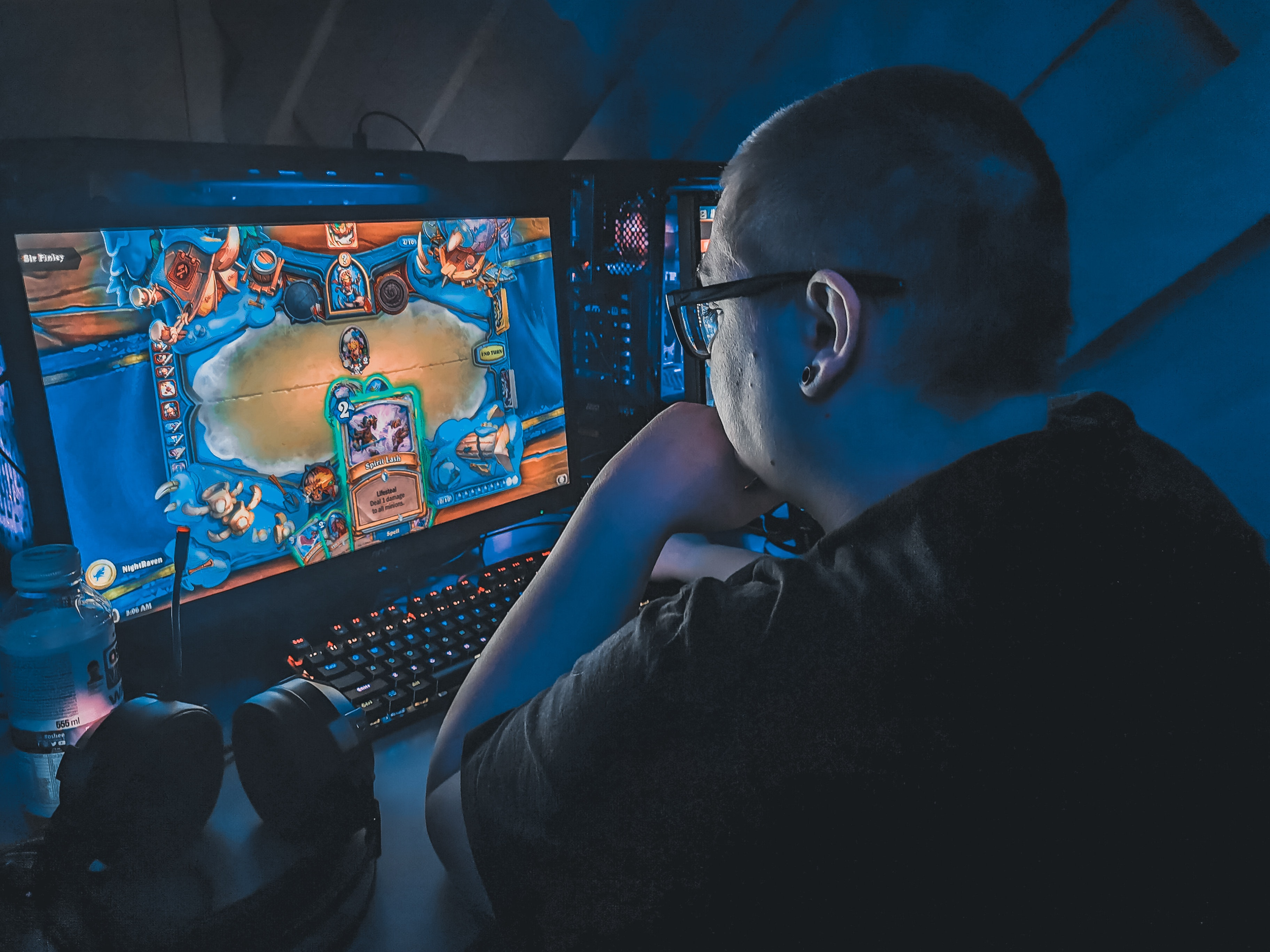 Overweight man playing video game at night · Free Stock Photo