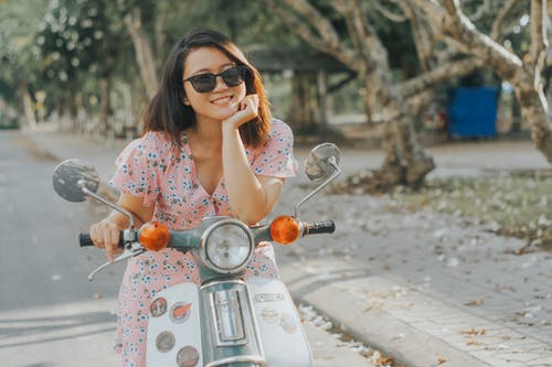 Woman In Floral Dress Riding A Motorcycle
