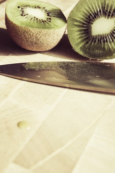 Sliced Kiwi Fruit Near Knife