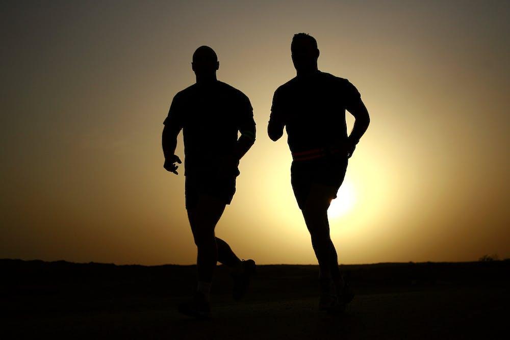 Two men running outdoors.   Photo: Pexels