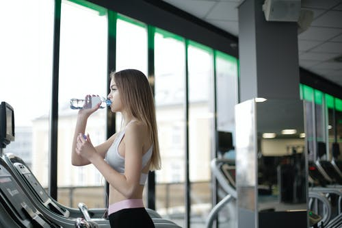 Woman Standing Near The Window While Drinking Water