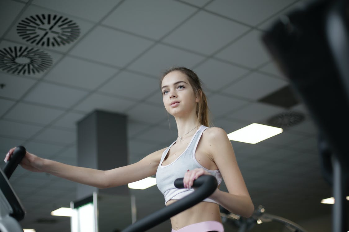 Woman On A Gym Equipment Doing Exercises