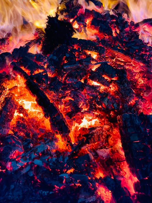 Bright hot fire of campfire with coals