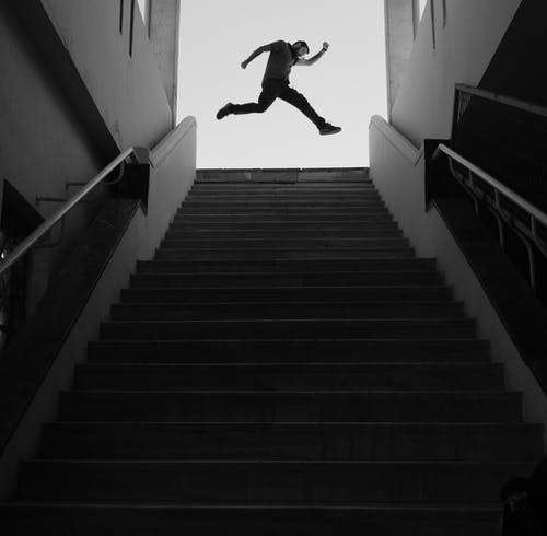 Man Jumping On Top Of A Stairs