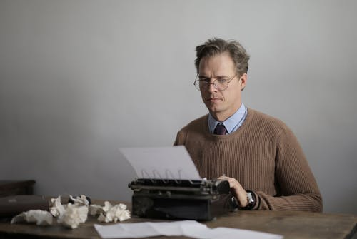 Man In Brown Sweater Typing