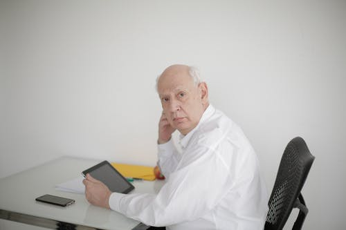 Senior male executive using tablet in contemporary workplace