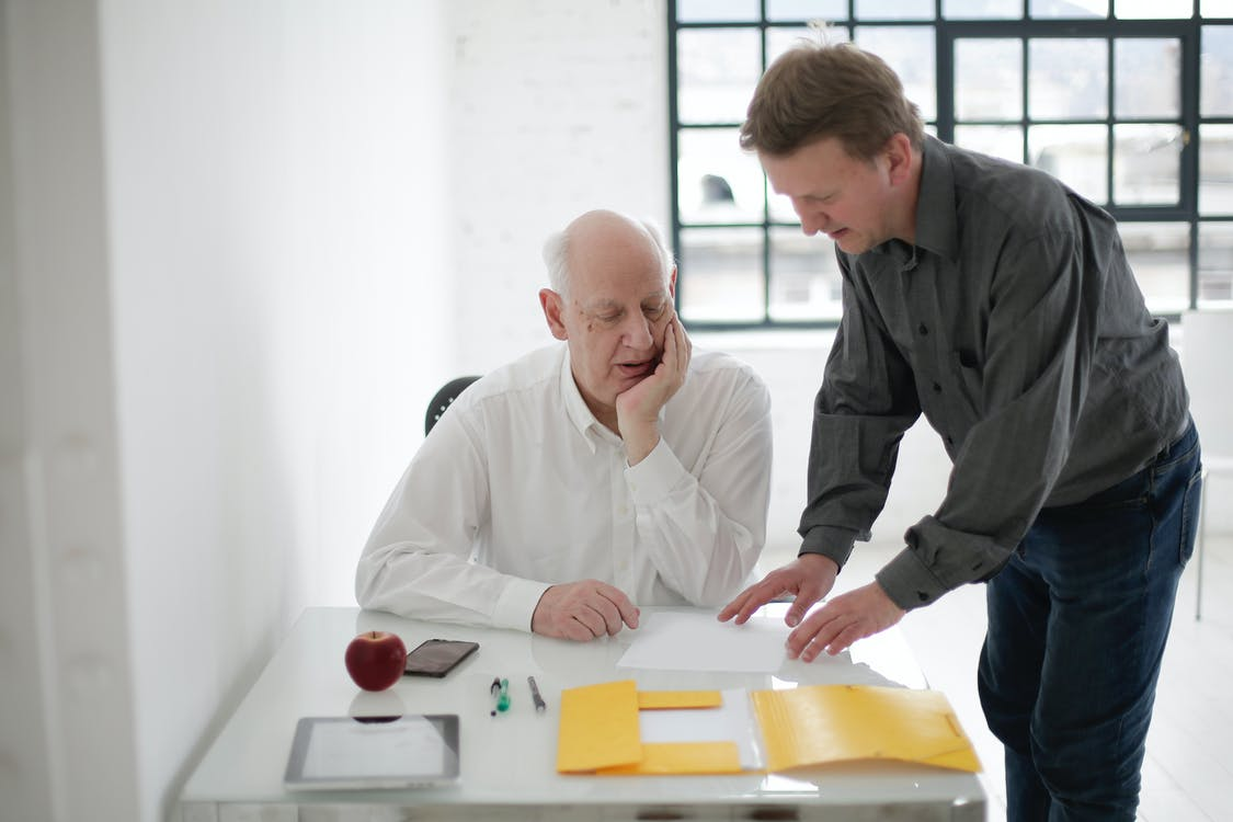 Focused positive coworkers working with documents