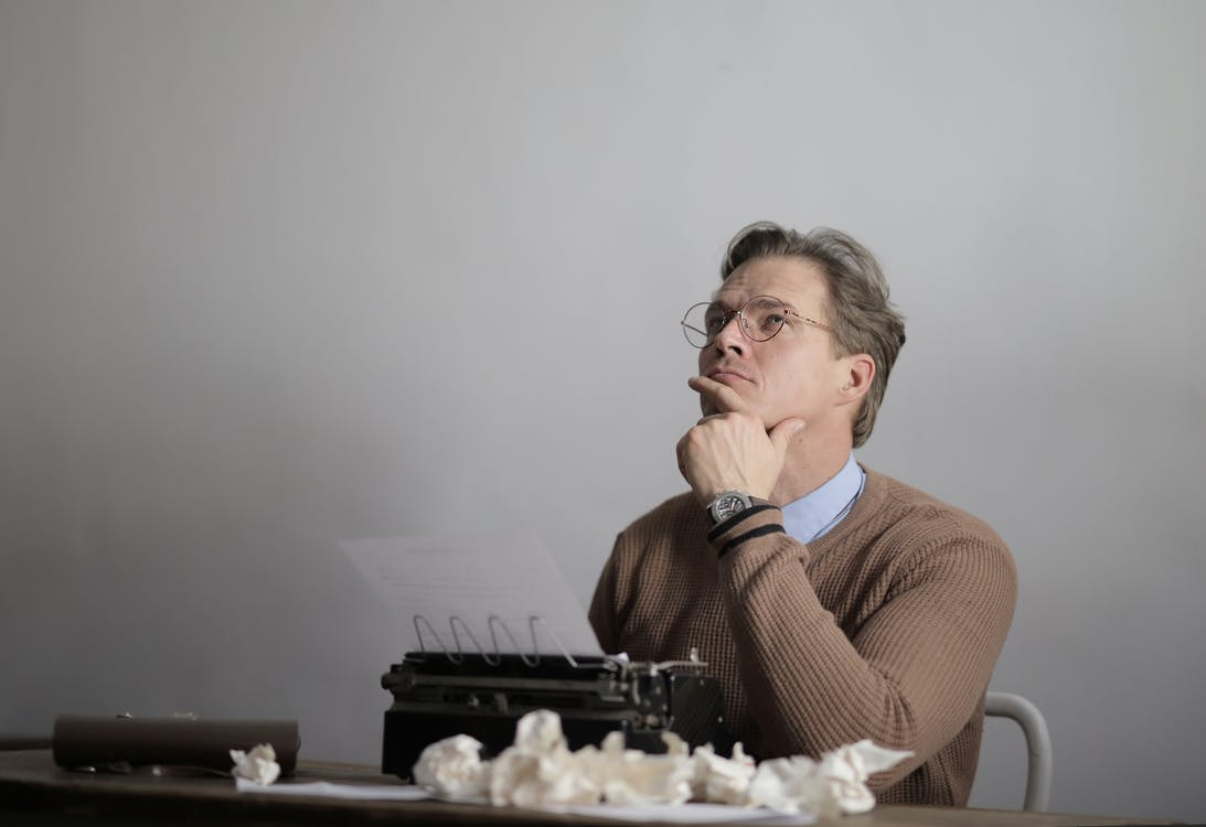 Adult thoughtful writer creating new article