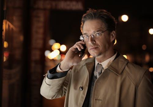 Adult man talking on smartphone on street