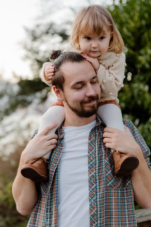 Photo Of Man Carrying Toddler